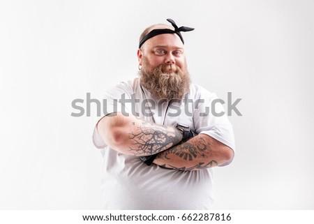 Cool fat man with beard posing #662287816