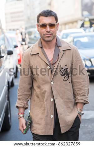 MILAN, ITALY - JUNE 17: Fashionable man poses outside Les Hommes fashion show during Milan Men's Fashion Week on JUNE 17, 2017 in Milan. #662327659