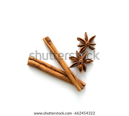 Two brown vegeterian cinnamon sticks lying on the table, spicy and healthy, topview Royalty-Free Stock Photo #662454322