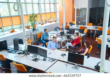 Startup business people group working everyday job at modern coworking  office space #662529757