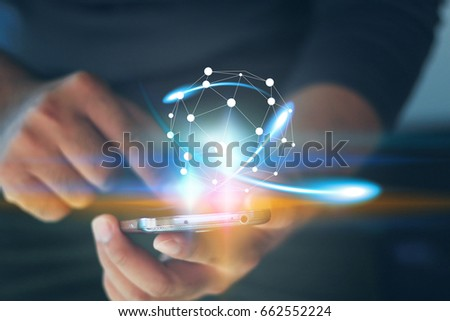 Businessman holding glowing globe. #662552224