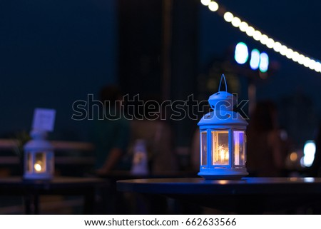 Earth hour 2020 concept. Lantern or Eid lamp with candle inside at night. Ramadan Kareem background. #662633566