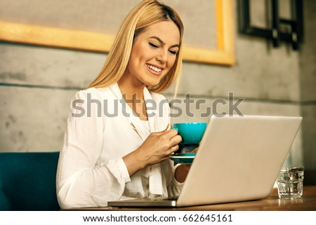 Modern business woman is using laptop in coffee shop. #662645161