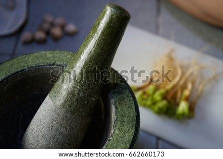 Mortar, pestle and coriander root #662660173