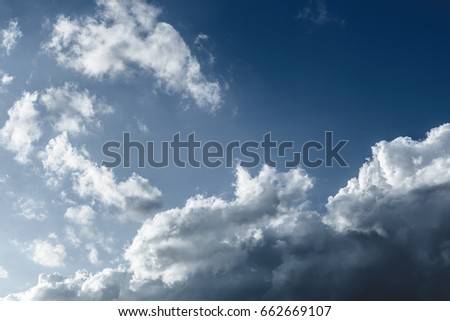 Sky blue, clouds with deep shadows, pre-storm clouds. Natural background Royalty-Free Stock Photo #662669107