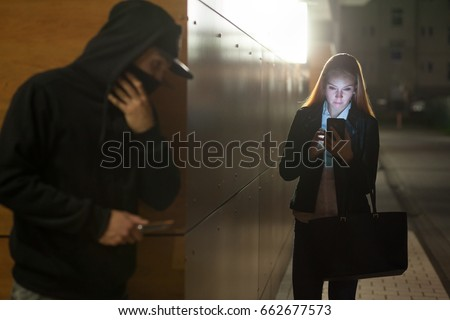 thief at night lurking in the shadows Royalty-Free Stock Photo #662677573