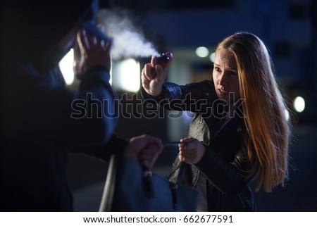 pepper spray or tear gas for self-defense by woman Royalty-Free Stock Photo #662677591
