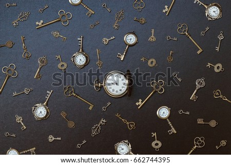 pocket watch and old keys. Vintage Wonderland background. Soft selective focus