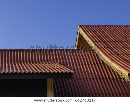 thai traditional roof tile against with blue sky #662763217