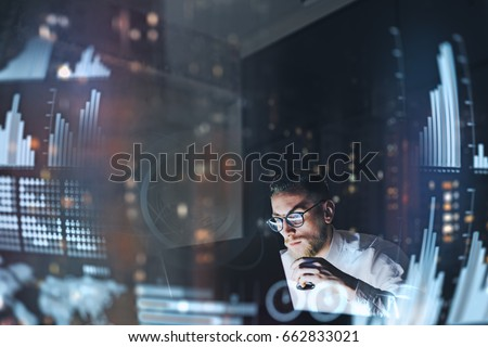 Concept of digital diagram,graph interfaces,virtual screen,connections icon.Young finance analist working at modern office.Man using contemporary laptop at night,blurred background.Horizontal #662833021