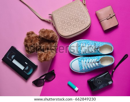 Keds, bag, sunglasses, purse, teddy bear, lipstick on a pink pastel background. Fashion look. 90s style. Top view. Flat lay. #662849230