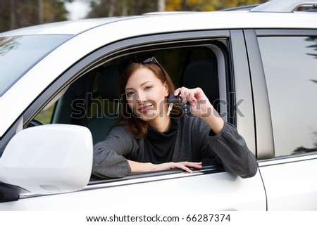 Portrait of happy successful woman with keys from the new car - outdoors #66287374