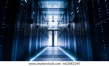 Shot of a Corridor in Large Working Data Center Full of Rack Servers and Supercomputers. #662882245