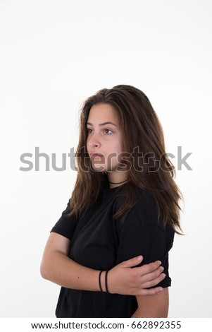 sad girl in white background with hand in arms #662892355