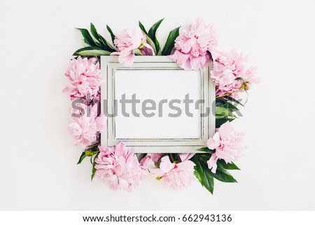 Pastel wooden frame decorated with peonies flowers, empty space for text