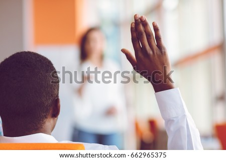 African american Business people Raising there Hand Up at a Conference to answer a question Royalty-Free Stock Photo #662965375