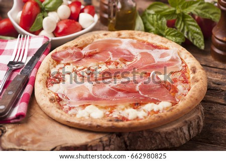Italian Pizza on rustic wooden table #662980825