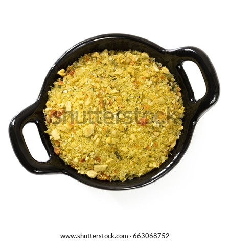 Stock powder in black dish, top view, isolated on white.