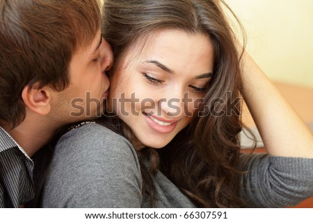 Young man kisses his beautiful girlfriend #66307591