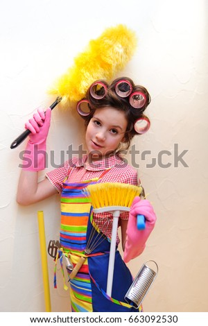 a young housewife with brushes and rollers #663092530