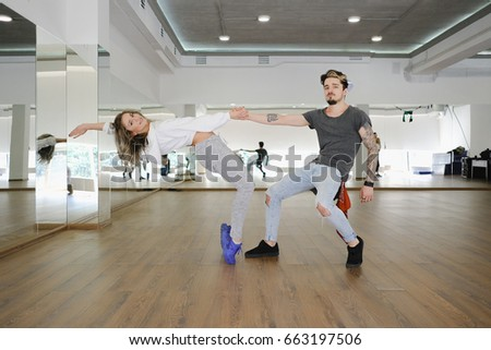 Young modern dancers dancing in the studio. Sport, dancing and urban culture concept #663197506