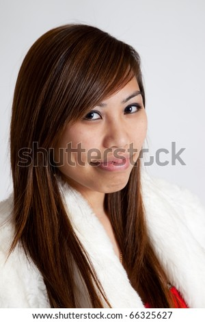 Lovely Asian woman  with white fur coat #66325627