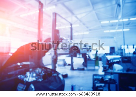 Auto repair service. Blurred background. Royalty-Free Stock Photo #663463918