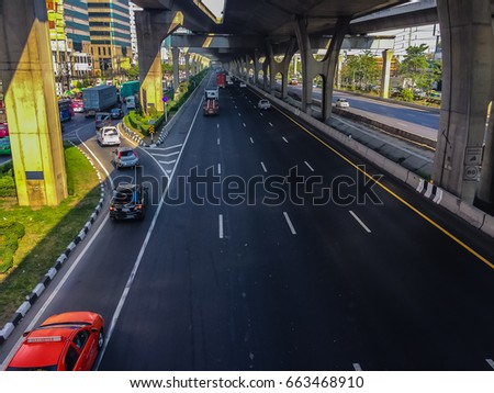Bangkok, Thailand - March 14, 2017: Traffic flow at the street in front of Central Bangna department store, Bangna-Trad expressway from Bangkokk to Trad province, the far eastern part of Thailand. #663468910