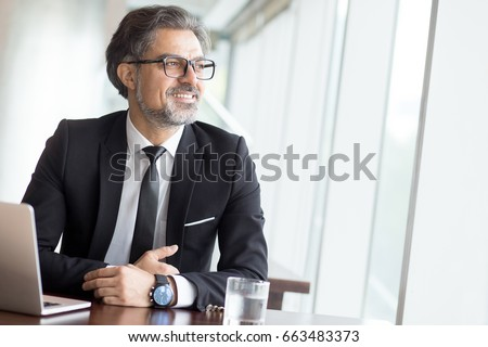 Ambitious businessman working on new project #663483373