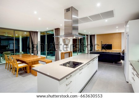 Luxury interior design pool villa in kitchen area which feature island counter and built in furniture home, house , building , hotel , resort #663630553