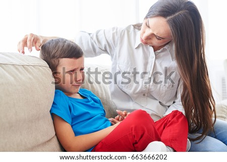Close-up shot of young mother trying to comfort and calm down her crying child  #663666202