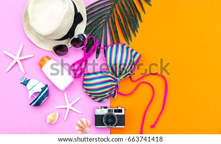 Summer Fashion woman swimsuit Bikini,outfit for to essentials travel. Tropical sea. top view. Colorful background. top view, copy space. Vacation concept