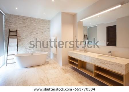 Luxury bathroom features basin  and bathtub home, house ,building #663770584
