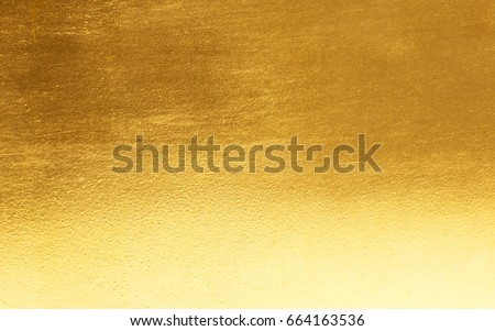 Shiny yellow leaf gold foil texture background #664163536