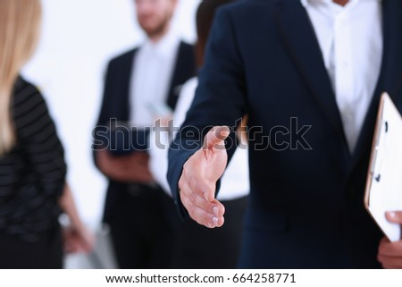 Businesswoman offer hand to shake as hello in office closeup. Serious business, friendly support service, excellent prospect, introduction or thanks gesture, gratitude, invite to participate concept #664258771