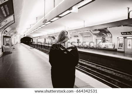 Black and White Photo of Girl in the Metro in Paris