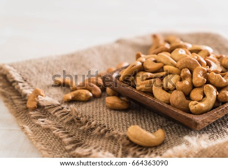 Roasted cashew nuts in bowl #664363090