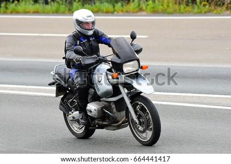 FRANKFURT,GERMANY-JUNE 17: unknown Rider on the freeway on June 17,2017 in Frankfurt,Germany. #664441417