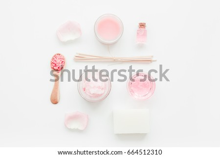 body treatment with rose extract and cosmetic set white desk background top view #664512310