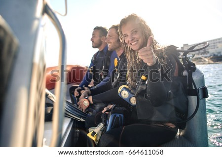 Group of scuba divers on a boat Royalty-Free Stock Photo #664611058