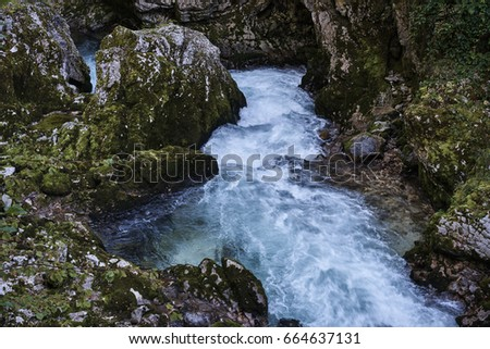 Amazing view of natural waterfall with crystal clear water among green woods in summer.                                #664637131
