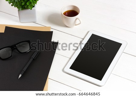 Modern workplace with digital tablet computer and mobile phone, cup of coffee, pen and empty sheet of paper. #664646845