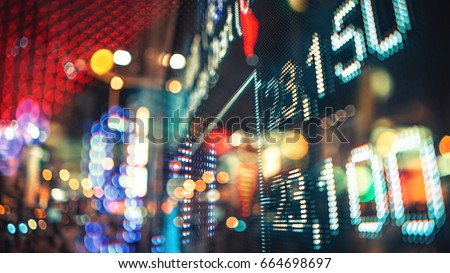 Display of Stock market quotes with city scene reflect on glass Royalty-Free Stock Photo #664698697