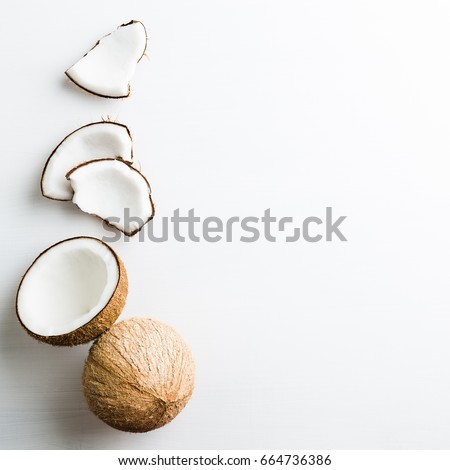 Tropical fruit whole and half abstract background .Coconut on white background. from top view #664736386