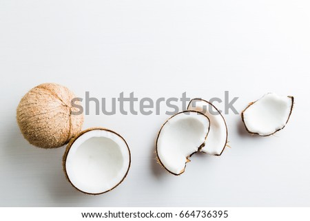 Tropical fruit whole and half abstract background .Coconut on white background. from top view #664736395