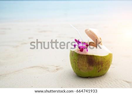 Fresh coconut on the beach #664741933
