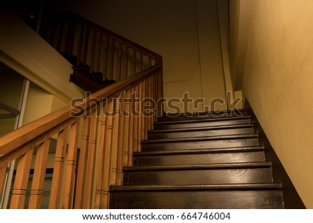 Wooden stairs, climb up to the darkness a lonely-looking path, fearful that there will be some mysterious thing under the shadows, Dim light. #664746004