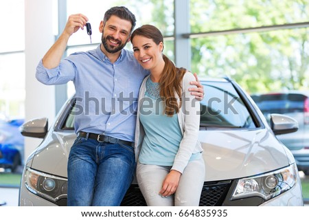 Young couple buying a car  #664835935