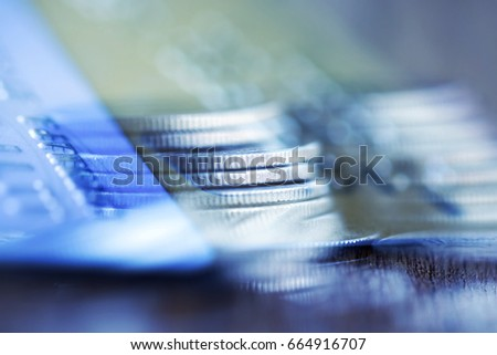 Double exposure Rows of coins of Credit cards on the table,finance and business concept,Money,soft focus and blurred style,dark tone. #664916707
