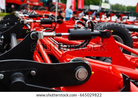 Close up of pipe system of hydraulic valves in agricultural machinery #665029822